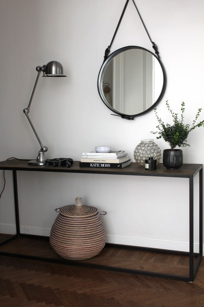 Stylish entry with some unique details like the Jielde lamp