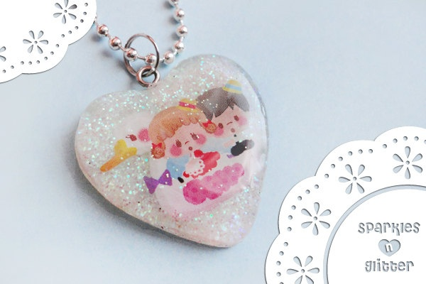 Cute couple on a swan Resin Pendant  Made with Resin and Glitter