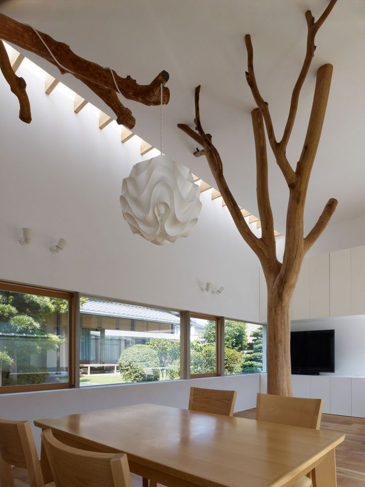 Magnificent Modern Residence You Should Choose: Ingenius In Garden Tree With Wooden Desin Of Table And Chairs On Above The White Lamp