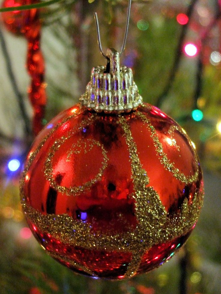 """Christmas Ornaments 4:  Red Christmas ball with gold glitter design, hanging on a Christmas tree.  Christmas ornaments, Xmas, Christmas decorations, Christmas ball, Christmas tree.  Image size 1125 x 1500px; prints at 3.75 x 5""""."""