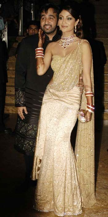 Shilpa Shetty at her wedding reception in a beautiful sari-gown.