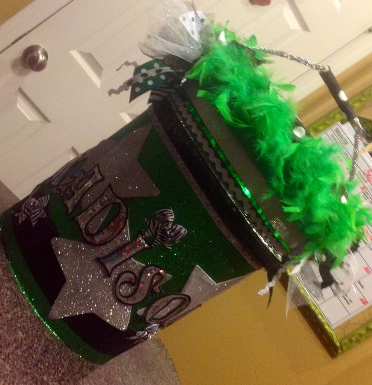 Cheer Bucket *Adding materials used to make* 1-5 gal bucket Foam & material to make bucket seat 4-green, foam glitter sheets from Hobby Lobby 3-silver, foam sheets (stenciled & cut out stars) 1-green boa from the $Tree Lots of ribbon trim!! Glitter stickers from Hobby Lobby Name is iron on letters from Hobby Lobby Hot glued everything to bucket :)