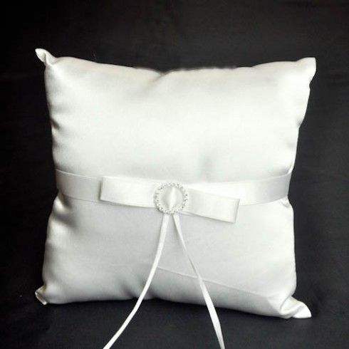 White ribbon and diamonte decorated wedding ring pillow