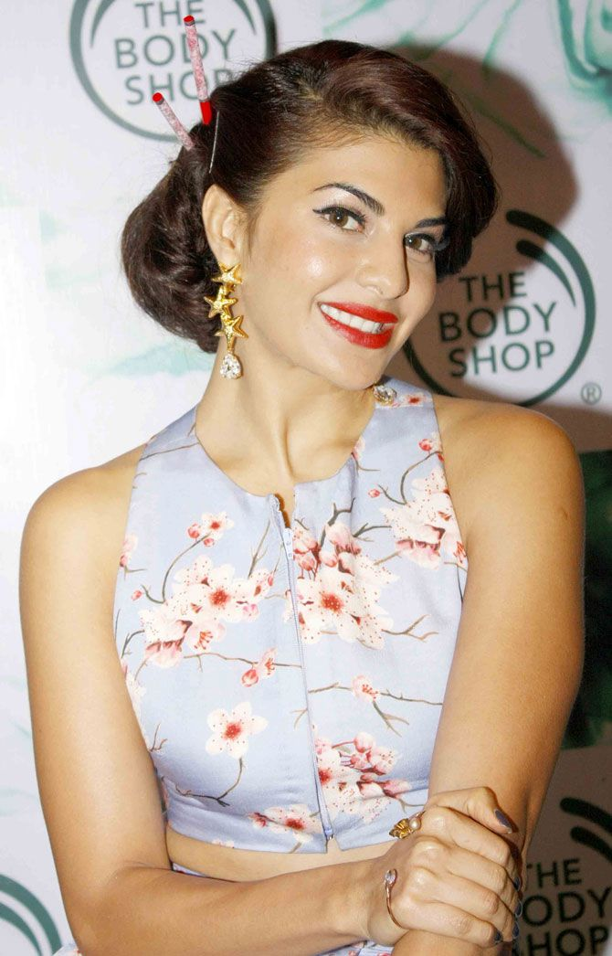 Jacqueline Fernandez lookeing stunning in a light purple designer dress with a…