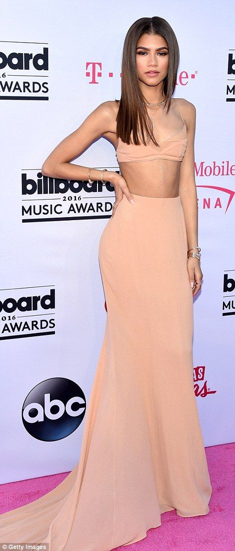 Making an entrance: Zendaya wowed in a peach two-piece gown and poker straight locks...
