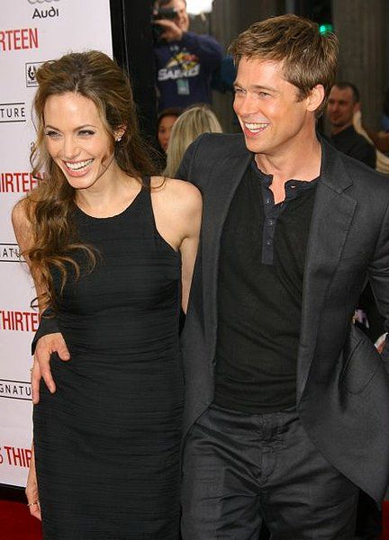 OMG...an actual naturally happy photo of Angelina Jolie/ Brad Pitt