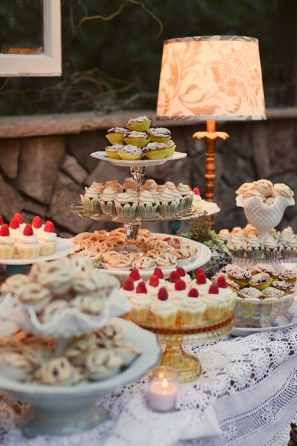 we used vintage cake stands & plates like these to display our cupcakes. photo by wildflowers photography.