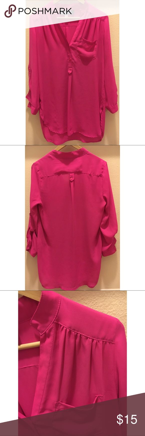Langford market Blouse In hot pink size medium Hot pink blouse by Langford Market. Size medium. 3/4 length sleeves. Button at cuffs with option to roll up. Pocket Detail in front. 100% polyester. Hits below hip. Pre owned excellent condition. langford market Tops Blouses