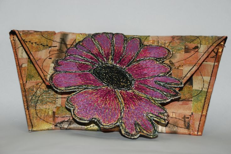 Clutch out of an old book and machine embroidery.