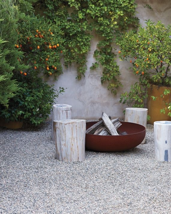 pea gravel and a fire pit that is truly cool (and hot i'm sure) --> Gravel and Stone