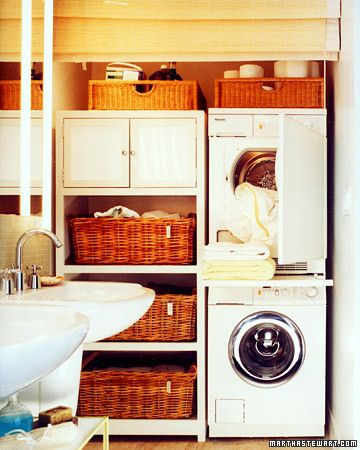 Tight-Space Laundry  In the compact laundry workstation and storage area of a small bathroom, the stacked European-style washer-dryer set economizes space. A shelf between units pulls out for folding items fresh from the dryer, then slides out of sight. A matchstick shade lowers all the way to the floor, gracefully hiding the utility area when guests are expected.