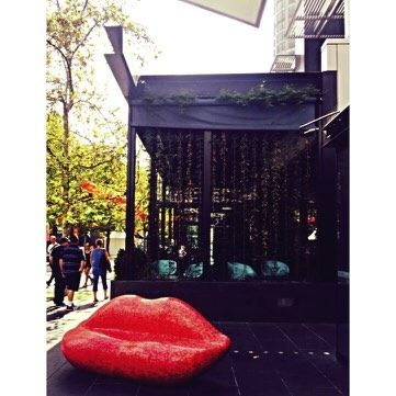 2) Get seduced with this bold red lip seat! Signifying the kiss 'BACI' the cafe's entrance is hard to ignore an absolute dynamic focal point. Constructed out of moulded plastic for durability its definitely not built for comfort but sure is a fun and cheeky addition to this space! | Baci Cafe