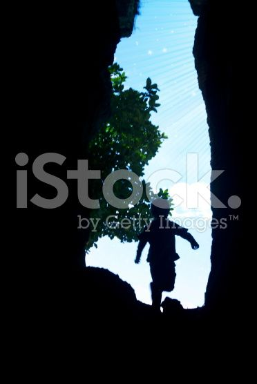 Child Running through Hole to Light and Stars royalty-free stock photo