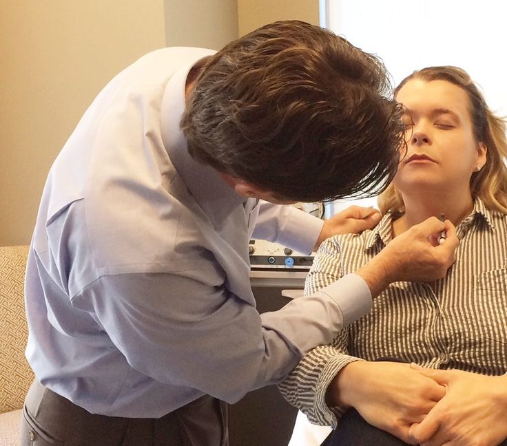 Dr. Griffin prepares the chin and neck area for Kybella injections.