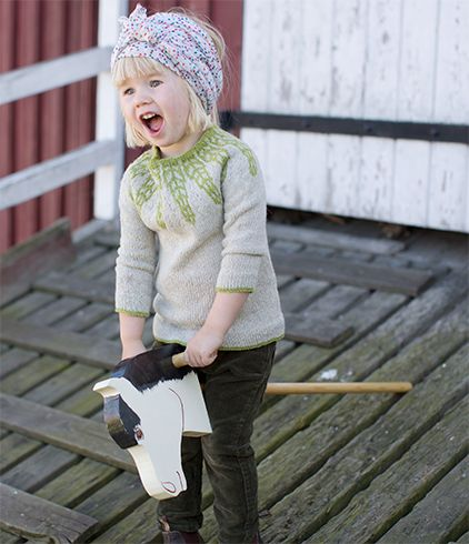 A yoked children's sweater in slightly marled yarn. Folded hems create a professional appearance, and give the sweater a smock-like look.