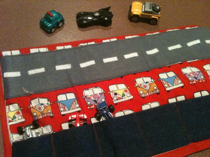 Inside of the car mat I made. It has 6 pockets for cars and a road and it folds into 3. Good for quiet play on long trips or cafes or church. I'll p[ost the fold up version and outside with this one from the VW Kombi featured fabric and denim.