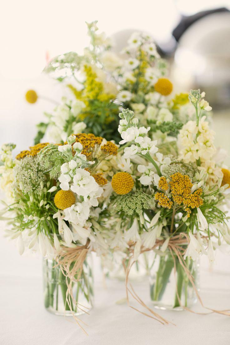 outdoor-spring-wedding-yellow-white-wedding-flower-centerpieces