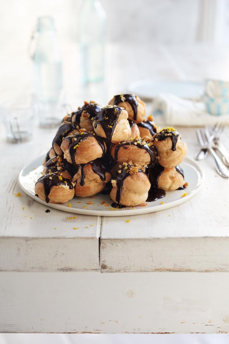 Waitrose - Hazelnut and chocolate profiteroles filled with praline cream and smothered in warm chocolate sauce
