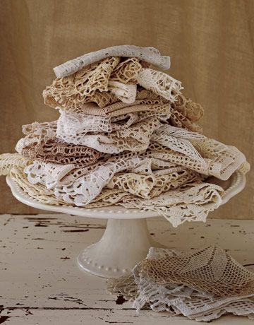 Piles of beautiful vintage doilies- beautiful crafts and displays.  I need to do this w/the pieces i have until i find the place to use them.  Now i just need to look for a cake clate!