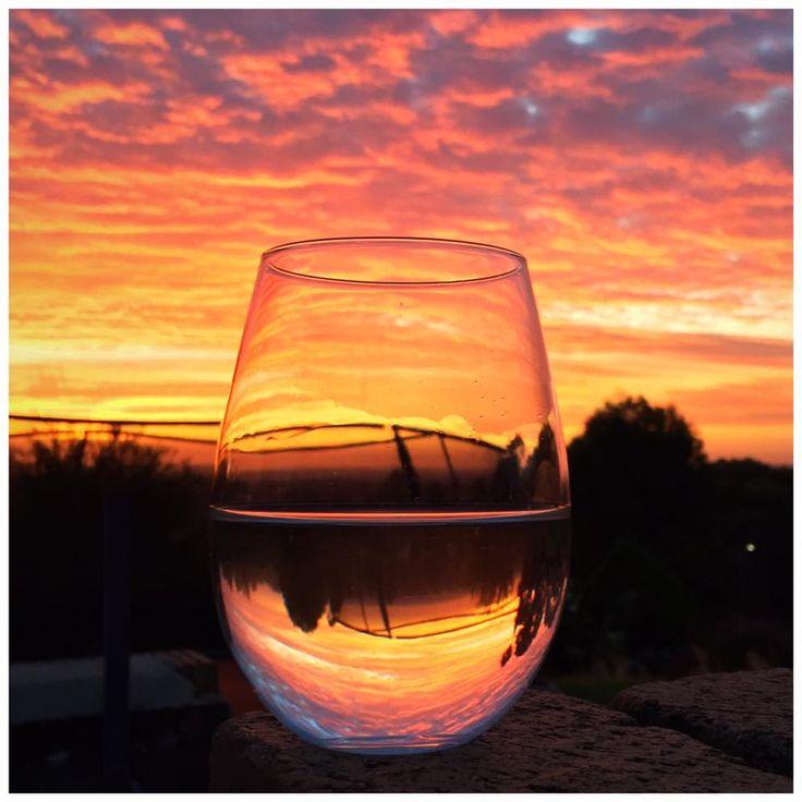 Captured a sunset in my wine glass. Fire in the sky. carol@wearingmemoris.com