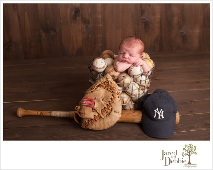 Newborn Baby Boy in baseballs Jared and Debbie Photography #Yankeesbaseball