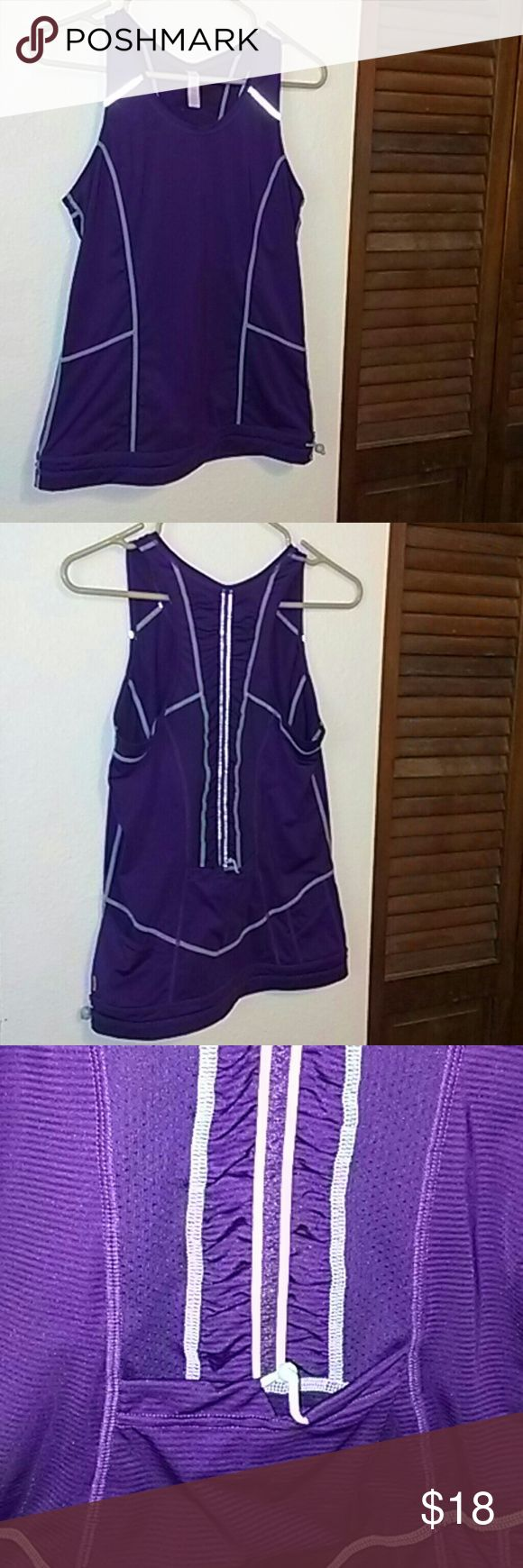 Pretty Lucy athletic tank Lucy athletic tank in EUC! Purple with teal. Side pockets and rear pocket. Super cute! Lucy Tops Tank Tops