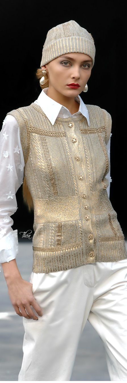 shimmery gold sweater vest over beautiful white blouse and pants