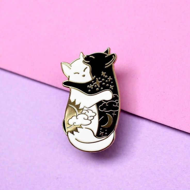 #Repost @glitter.punk Guess what's back?!! These babies have been re-released link to buy in my bio!! . . . Image description: an enamel pin against a purple background featuring a pair of black and white cats hugging each other with day and night motifs