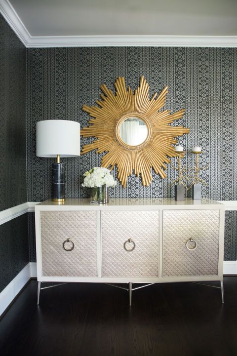 A gold sunburst mirror adds a touch of glamour to Singla's formal dining room.