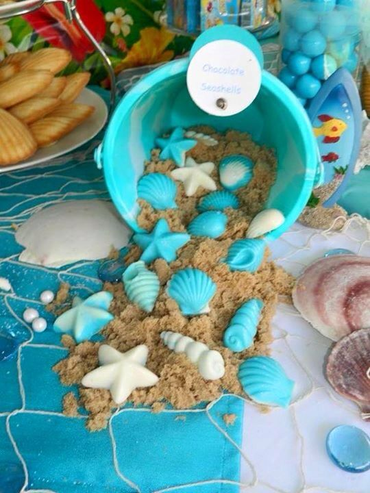 Chocolate sea shells over a mix of white & brown sugar