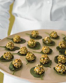 Love these hors d'oeuvres. So simple to make. Balls of fresh goat cheese, coated with chopped pistachios; atop fresh spinach leaf.