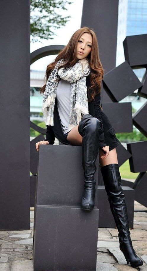 Asian girl in high boots valuable