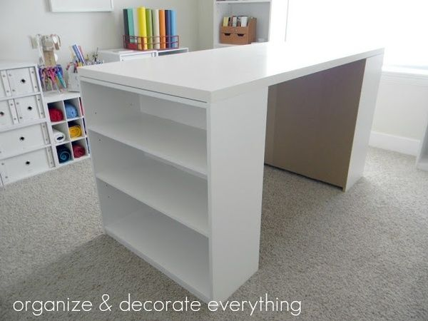 DIY Craft Table; tabletop at IKEA for $25 and two $15 Walmart bookshelves.    Totally doing this for my craft room