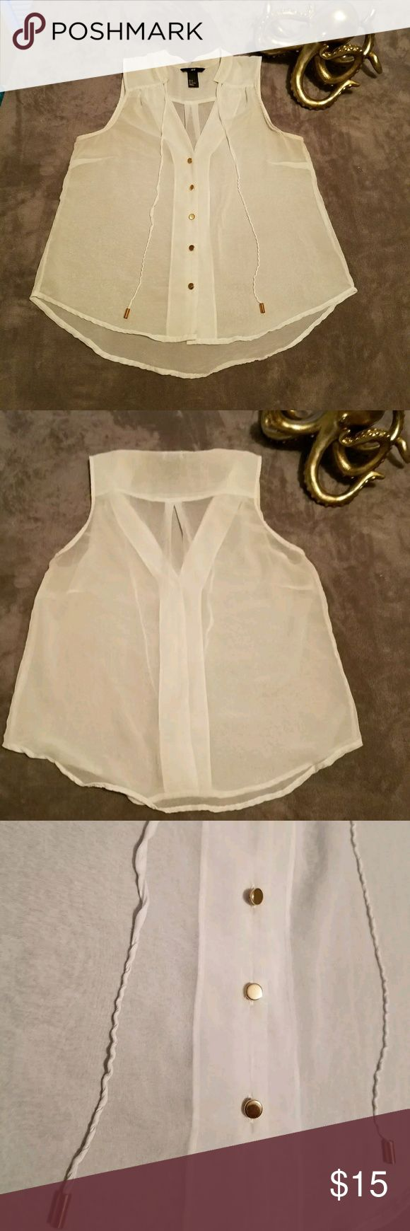 H&M White Sheer V Neck Gold Button Down Shirt Sz 8 H&M White Sheer V Neckline Gold Button Down Shirt Sz 8  White Sheer See-through Top. Sleeveless Tank Top.  V Neckline and Gold Button Down & Ties in the Front Blouse.   Great for Date Night, Girls Night, Work or Casual Social Events.  Measurements: Armpit to Armpit - 11 Inches (Double for Full Width) Bottom Width - 21 Inches (Double for Full Width) Length - 23 Inches  100% Polyester  Worn a Couple Times.  Great Condition. H&M Tops Button…