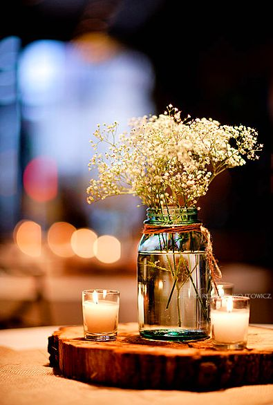Wedding table center pieces with wood block and babies breath. love love love this one it would be simple and cheap perfect!