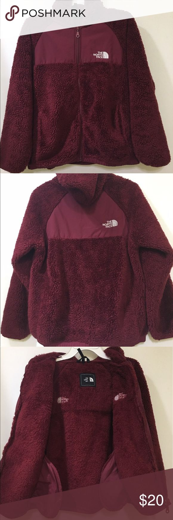 Girls North Face Jacket - Burgundy Ready to layer during cold-weather adventures, this soft midweight fleece hoodie for girls is finished with comfortable ribbed cuffs and hem. Embroidered logo on front and back. Gently used. Clean. The North Face Jackets & Coats