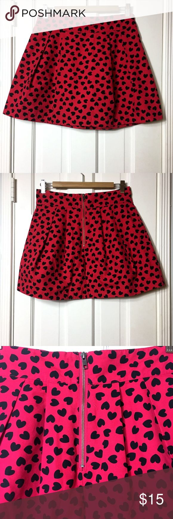 Divided red hearts mini skirt sz 4 Divided red hearts mini skirt sz 4 Made in: China Size: 4 Fit: fitted waist, flare bottom Waist: 28 Hips: 38 Length: 15.5 Material:cotton exterior, polyester lining Colors: red, black  Condition: excellent, like new #CoxyCloset #skirt #miniskirt #divided #hearts #cotton #minnie #casual Divided Skirts Mini