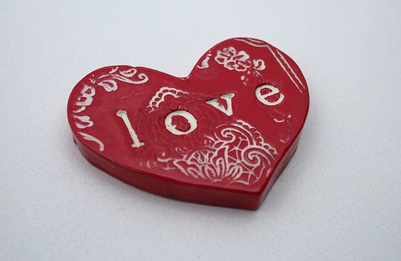 Ceramic heart shaped tile. Rich red and white with love stamped in..    Stunning Individually Hand Crafted Glazed terracotta by the Monster