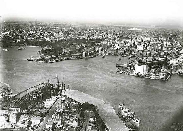 Old Sydney ~ Aerial view of Sydney Harbour - the bridge is under construction  Sydney Harbour Bridge. Approaches from the Air.