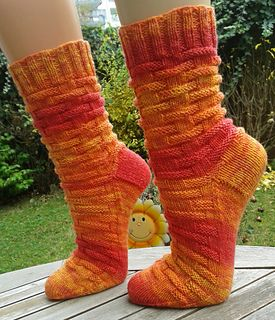 Awesome free pattern uses Opal Jahre Anniversary sock yarn color number 9285 (Candles).