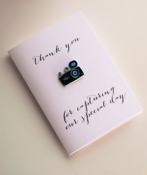 Say thanks to your photographer for capturing the wonderful moments of your big day with this gorgeous quilled card.    Every paper strip in this