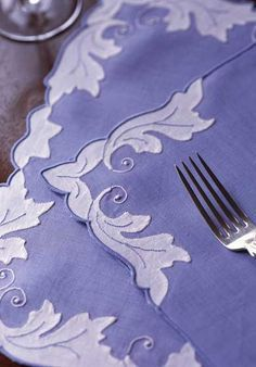 Blue Linen Mats & Napkins: Hand appliqué leaves in white with embroidered veins. Made to order in Madeira.