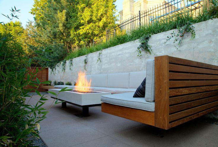 Modern landscape. Wood bench. Concrete. Backyard. Outdooring.