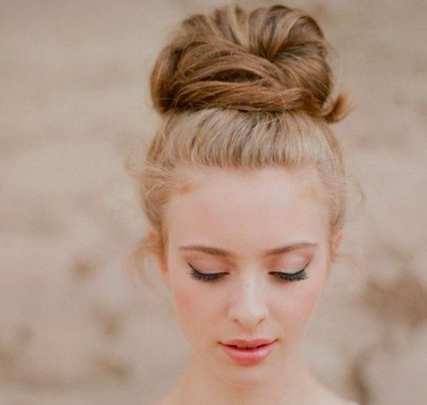 Forget about the topknot being just for an everyday look. Create a slick and smooth top knot to create a perfect and simple wedding hairstyle.