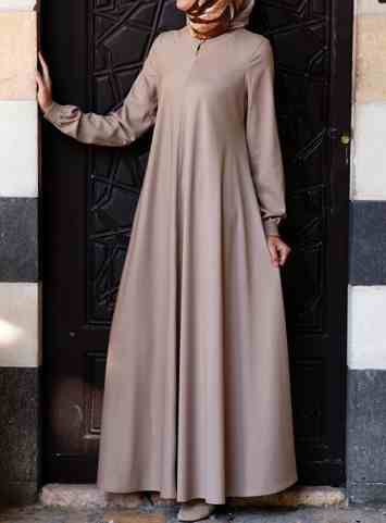 Easy Care Flared Abaya Almondine color You asked for it, and we are happy to oblige: Finally, a wrinkle-resistant version of our popular abayas! The name says it all, and it's as easy to wear as it is to care for. Elasticized sleeves, a front opening, and the perfect flattering, feminine flair work together to create one beautiful, practical piece you'll be reaching for day after day.   Price: $124.95 $109.95