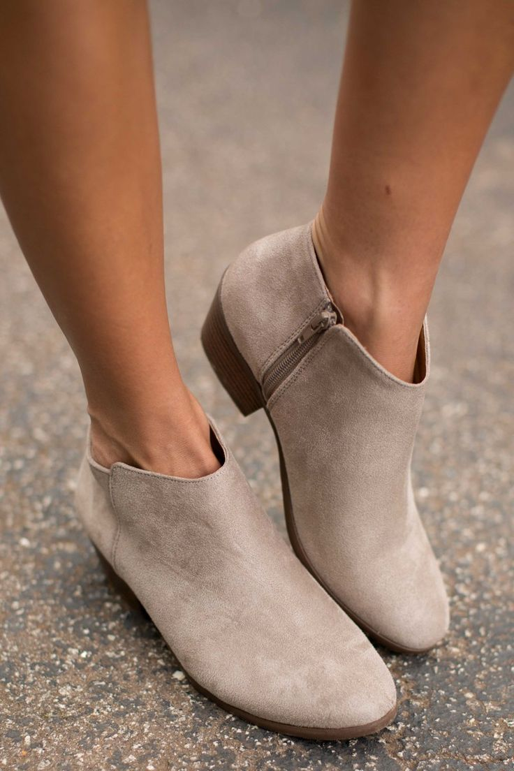 "We all know you're the Cool Chick, and in these Taupe Ankle Boots, everyone else will know too! You don't even have to try! These suede booties feature a side zipper, a low heel, and a rounded toe.   • Heel measures 1.5"" • Non-skid sole • Vegan friendly, man made materials • Imported"