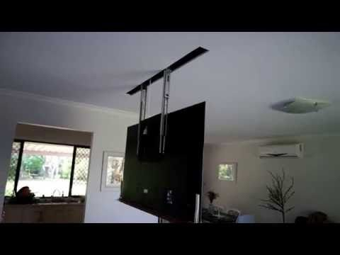 A word from the creator ''The rig I made to raise and lower my Sony TV (X90C) from inside the roof. It's driven by a garage door motor, supported by steel ca...
