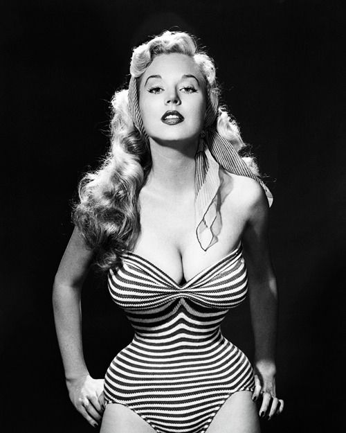 U.S. Full-breasted and narrow-waisted Betty Brosmer, 1953. Betty Brosmer was the highest paid supermodel of the 1950s – winning more than 50 beauty contests before the age of 20 yrs old, posing for more than 300 magazine covers, and stunning men and women alike with her insane hourglass figure (38″-18″-36″)! She married the fitness icon Joe Weider in 1961, and joined his fitness lifestyle empire.