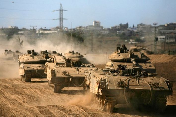 Column of Achzarit armored personal carriers and Merkava Mk 4 tanks