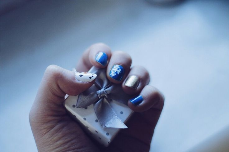 Manicure, snow flakes, snowman, blue and gold nails. Winter manicure.